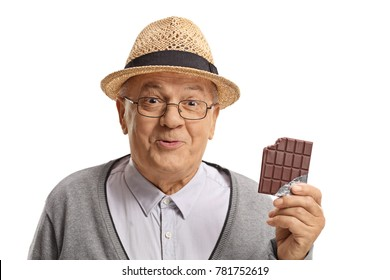 Happy mature man holding a bitten chocolate bar isolated on white background