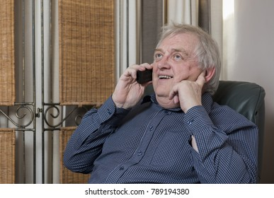 Happy mature man laughing and talking on the phone