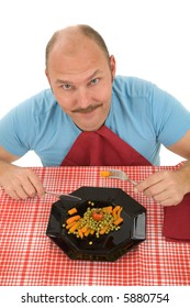 Happy mature man on a diet eating his vegetables