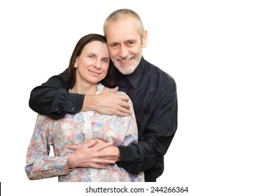 Happy mature man and woman smiling for S. Valentine's day or anniversary and embracing each other. Isolated on white background.