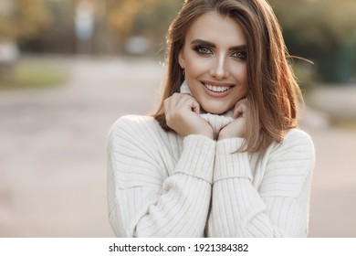 Happy mature woman with arms. Beautiful young woman feeling good and enjoying freedom, copy space.