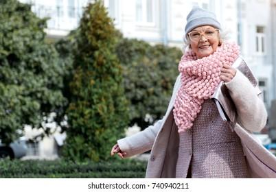 Happy mature woman enjoying walk in town