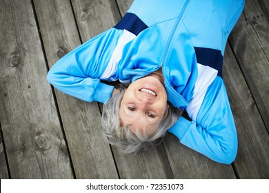 Happy mature woman having rest outside