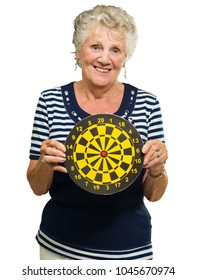 Happy Mature Woman Holding Dart Board Isolated On White Background