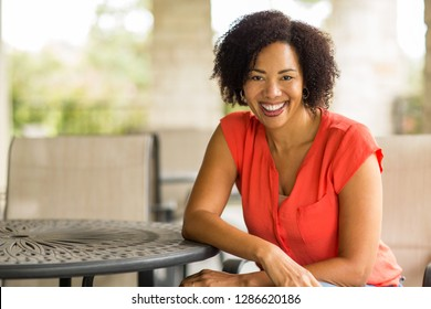 Happy mature woman smiling.