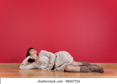 happy mature women laying down in the floor of his new house