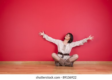 happy mature women sited in the floor of his new house
