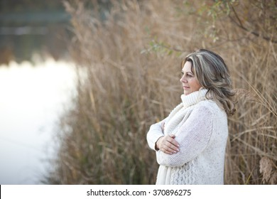 Happy matured woman in fall  smiling