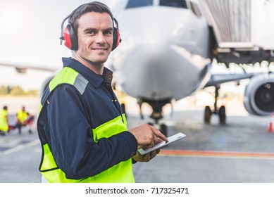 Happy mechanic having job in airdrome