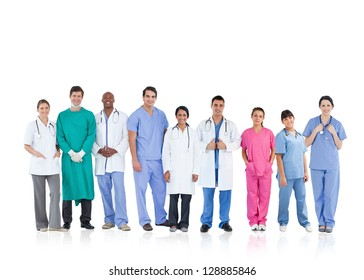 Happy medical team standing in line on white background