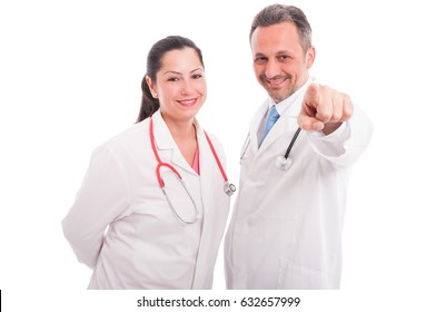 Happy medics or doctors pointing finger on you as healthcare and medicine concept on white background