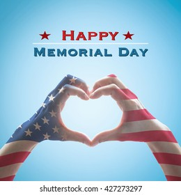 Happy memorial day with America flag pattern on people's hands in heart shape