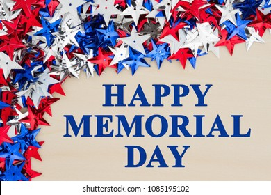 Happy Memorial Day text with red, white and blue stars on wood
