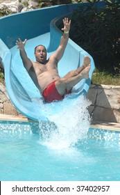 happy men have fun on aqua park