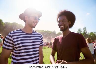 Happy men at the music festival