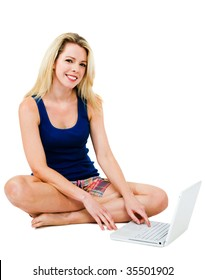 Happy mid adult woman using a laptop isolated over white