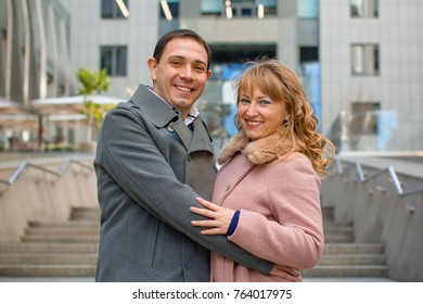Happy middle age couple in love having fun outdoors and smiling. Romantic happy couple kissing and hugging. Sentimental happy couple in love bonding