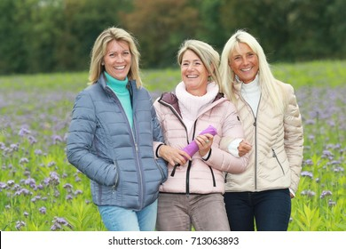 The happy middle age woman close together in nature environment