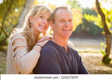 Happy Middle Aged Caucasian Couple Portrait Outdoors.