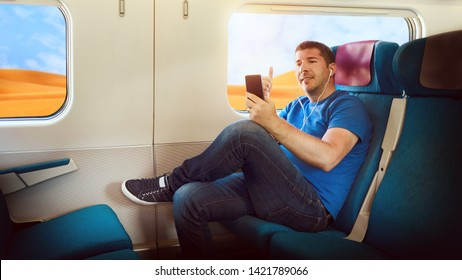 Happy middle aged man sharing content on streaming platform by smart phone - Millenial tourist having fun vlogging live feeds on social media network while traveling by train to discover world deserts