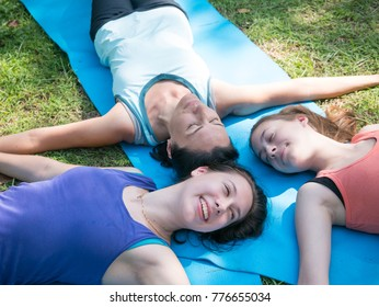 Happy middle aged mother and daughter sleeping lying and having fun together in the park. Portrait of happy women smiling and looking at the camera. Family concept