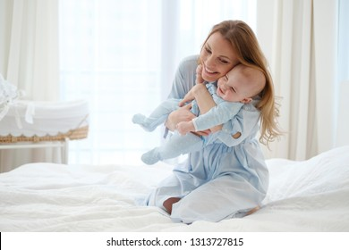 Happy middle aged mother with her child in a bed