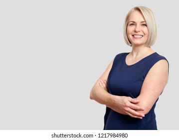 Happy middle aged woman isolated on grey background