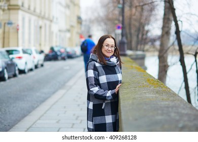 Happy middle aged woman walking in Paris, France