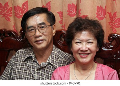 A happy, middle-aged asian couple.