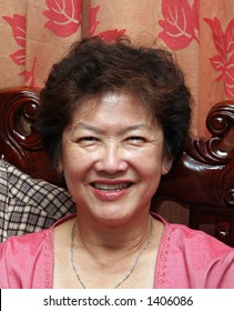 A happy, middle-aged asian woman.