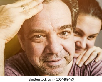 Happy middle-aged man and his wife close-up portrait