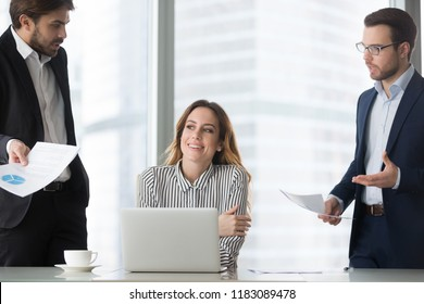 Happy millennial businesswoman lost in thought at workplace avoiding mad or annoying colleagues asking questions, smiling female boss or woman ceo dreaming in office abstracted from work