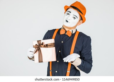 happy MIM holding gift box isolated on white