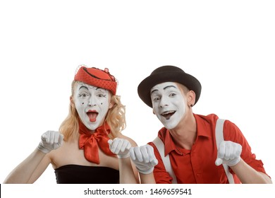 Happy mime woman and man looking over fence. Couple of emotional actors on white.