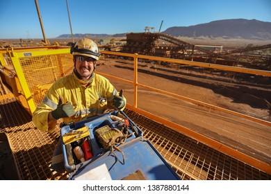 Happy miner (NDT) inspector setting on the chair raising his thumb up while conducting inspecting calibrating Non-Destructive Testing (NDT) services  construction mine site Perth, Australia