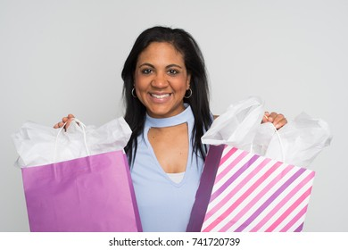 Happy minority woman with a blue outfit posing
