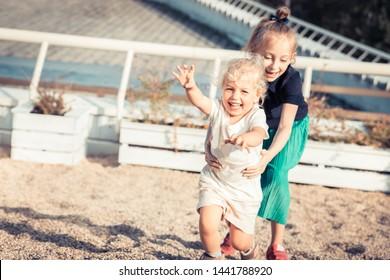 Happy mischievous children having fun together carefree childhood lifestyle