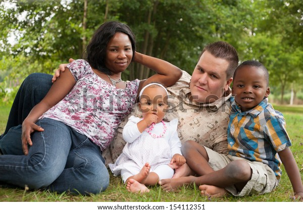 Happy mixed family is having a nice day in the park
