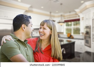Happy Mixed Race Couple Inside Beautiful Custom Kitchen.