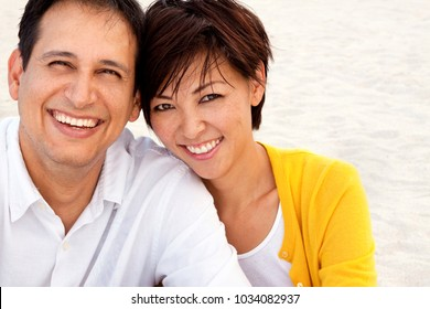 Happy mixed race couple laughing and talking.