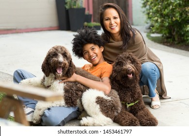 Happy mixed race family playing with their dog.