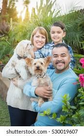 Happy Mixed Race Family Portrait Outdoors.