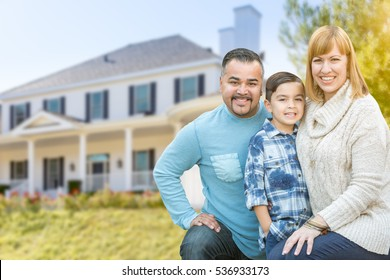 Happy Mixed Race Hispanic and Caucasian Family Portrait In Front of House.