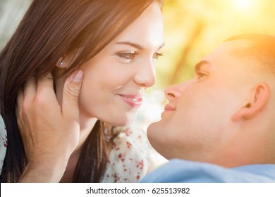 Happy Mixed Race Romantic Couple Portrait in the Park.