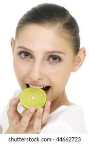 happy model eating Lime over white