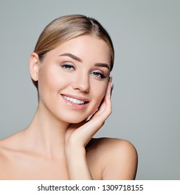 Happy model girl face. Pretty woman with clear skin. Facial treatment, skin care and cosmetology concept