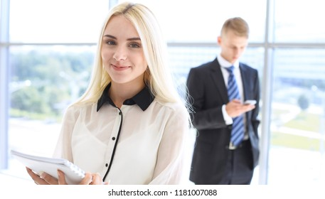 Happy modern business woman or student girl in office hall