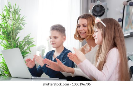Happy modern family using together pc laptop at home
