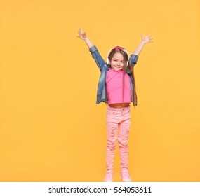 Happy modern kid with hands up