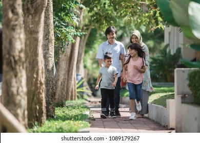 happy modern muslim family have fun near their house together